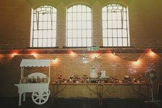 Sweet trolley / Candy Cart and dessert table - Image by Jess Petrie - Bride wore a beaded Lace Alexia Designs wedding gown to a vintage, rustic style wedding in the Kelham Island Museum, Sheffield. Groomsmen in navy suits.