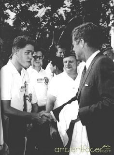 President Kennedy shaking hands with future President Clinton.