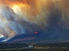 Falcon Stadium on the Air Force Academy is dwarfed by the fire - Tuesday June 26th