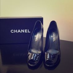 Chanel black patent leather peep-toe pumps. These classic shoes are a size 38 but fit me perfectly and my foot measures as a size 7. They are EXCELLENT condition and are extremely comfortable. (Only worn once or twice and only sign of wear is on the sole). No platform. Heel height 4.5 inches. Ships in original box. CHANEL Shoes Heels