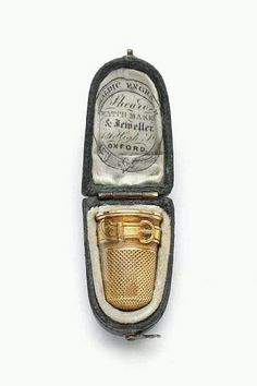 19th century Gold Thimble with Case / decorated with a strap and buckle motif ~ retailed by Shearo, Oxford / recently sold by Bonhams for $310.00. Source: expecttheunexpectedtoday