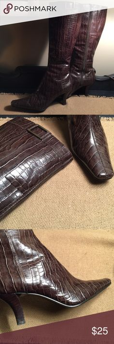 Dark Brown High Heel faux alligator leather boots Worn once for just a tiny bit! Great condition! These are a women's size 6 pair of dark chocolate brown leather upper, with a faux alligator type design! High heeled boots (approx. 2.5 in.) these are made by Bandolino and are a harder shiny type leather. These zip up the inner sides, have a small (hidden stretch area @ the inside top to help with fitting @ the calf. These have a neat antique gold buckle (for looks) at the top outside. These…