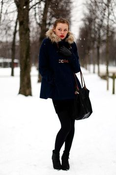 Snowy Street Style from the Couture Shows: Sometimes it's okay to mimic the mood Old Man Winter put you in--a dark ensemble pops out against a snowy background.