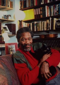 Morgan Freeman, books and a cat!   I'm truly in Love!   OMG