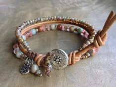 This beaded bracelet is made with,Impression jasper beads, Strawberryquartz beads, Miyuki beads, leather,a little boho charm and a metal button. Fits a wrist of 17 cm = 6.69 inch. Please read my policies before ordering.
