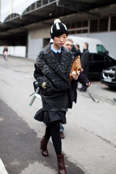 from her ankle boots to the white pom pom on her beanie, everything is amazing!