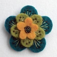 """Folksy :: Buy """"Layered felt brooch"""" - Fabric Crafts A beautiful, feminine brooch made from 3 layers of scrumptiously thick wool felt.Embroidered and beaded with metallic rainbow seed beads, and firmly attached to a 1 Felted Wool Crafts, Felt Crafts, Fabric Crafts, Sewing Crafts, Felt Flowers, Fabric Flowers, Fabric Flower Brooch, Felt Embroidery, Felt Brooch"""