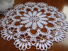 Crochet lace round doily all handmade with white cotton Size: Diameter : 15,8 inches, 41cm. Color: white Material: cotton thread n. 8 Conditions : new Every order from my shop will come to you with a little handmade gift. Instructions for care: Hand wash in cool water with a little