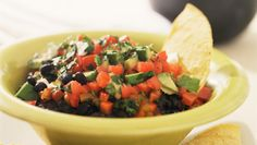 """This zesty corn, bean, and avocado dip is a Super Bowl party fave of legendary NFL quarterback, Steve Young. Young refers to the recipe as """"A.M.B Dip"""", named after his friend—the mastermind behind the dish. Young suggests serving it with lime tortilla chips"""