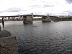 a group that appeared to be excercising, not racing the boat, Morrison Bridge and Williamette River - Portland, Oregon