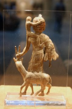 Tribute bearer with an oryx, a monkey, and a leopard skin    Period: Neo-Assyrian  Date: ca. 8th century B.C.  Geography: Mesopotamia, Nimrud (ancient Kalhu)  Culture: Assyrian  Medium: Ivory