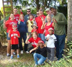 Alumni from Orlando volunteer at an alligator exhibit