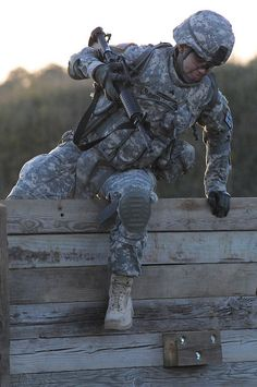 Sgt. Lauren Aldaco, U.S. Army Training and Doctrine Command Soldier of the Year, jumps over a wall to the next obstacle at the Stress Fire event during the Department of the Army Best Warrior Competition held Sept. 27-Oct. 2 at Fort Lee