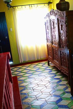 Handmade tiles can be colour coordianated and customized re. shape, texture, pattern, etc. by ceramic design studios.