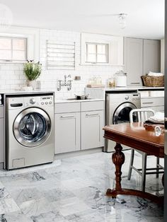 gray and white laundry room