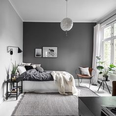 Bedroom with one black wall. Photo by Christian Johansson