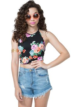 Get the freshest cuts in this blooming floral crop top! Halter neck with a self-tie at the neck with elasticized band. Bold floral print with black grounding. Unlined.