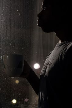 Watching the rain fall by tyfn, via Flickr | Canon XSi 50mm f/1.4, ISO 1600, f/2.8, 1/20