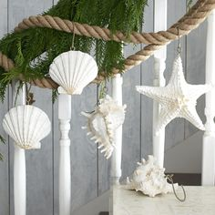 SEASHELL GARLAND - Adorned with lightweight resin seashells, scallops, and a starfish, nature's work of art is strung along a nautical rope.