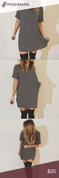 Brandy Melville striped tshirt dress Very soft. Great for lazy days when you don't feel like putting an outfit together or I always throw a leather jacket over it and wear it when I go out at night. Brandy Melville Tops Tunics