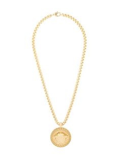 Shop Versace Greca Medusa pendant.