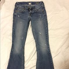 Silver 'Eden' Jeans Silver Jeans!  Waist:25 Length:33  They were barely worn but way too long for me which explains why the bottoms are torn.  Great condition otherwise and perfect fit.  Offers are welcome! Silver Jeans Jeans Flare & Wide Leg