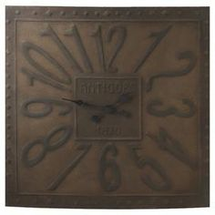 "Vintage-inspired metal wall clock with a studded border.  Product: Wall clockConstruction Material: MetalColor: BronzeAccommodates: Batteries are not includedDimensions: 32.75"" H x 37.25"" W x 2.25"" D"
