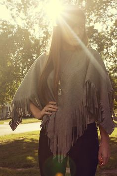 DIY Wool Poncho - So going to find a pretty patterned blanket at the thrift store to do this to!