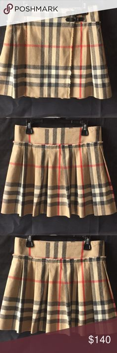 """🌸host pick🌸 Burberry skirt Authentic girls 14Y Burberry plaid skirt!  My daughter wore it one time!  She sprouted up like a bean stalk and it's a bit too short on her now .. dimensions are 14""""L( from top to bottom)x14 1/2W ((from side to side) . Would prob also fit a women's or juniors 0-3 I know when I was a bit smaller I could easily fit in a 14Y.  Hmmm. Maybe that's a good goal lol Burberry Bottoms Skirts"""