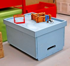 Stacking toy boxes that can be flipped over and used a play table