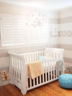 New mom, Kelle, created a peaceful nursery for son Xavier, using a gray-and-white color scheme. She carried a butterfly theme throughout with white butterflies in a wall decal and in a light-as-air mobile over the crib. Photo courtesy of Kelle Howard-Dean