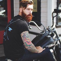 verymanlyman:  beardstofuck:  OH MY GLOB YES!!! red beard, tattoos, and a bike uggggh I love this.  Levi Stocke