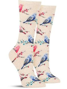 Time for a pair o' cute parakeet socks! Bird lovers will adore these fun animal socks featuring chirping little beauties perched on twigs. We even spy some flowers blooming! These pretty socks would b
