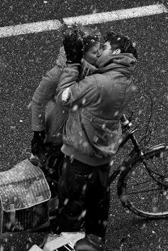 Kissing in the first snow.... | kiss | snow | snowing | bicycle | love | lovers | cold | winter | street | ride | cycle