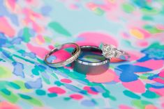 Wedding ring detail photo on bright pattern background