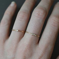 -solid 14kt gold -1pt diamond (clarity VS1/2) and (size 0.25 carats) -1mm ring band The most delicate and simple gold ring with a dash of sparkle from a solo 0.