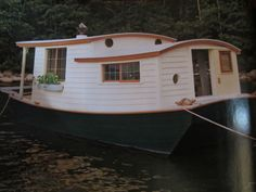 Benjamin Guy is the owner of this wonderful tiny house boat.  It was featured in the Feb. 2012 issue of Wooden Boat magazine.
