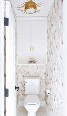 A dark and dated ensuite gets a glamorous update - Water closet dressed in floral wallpaper and geometric floor tiles {PHOTO: Phil Crozier} - Cabinet Above Toilet, Bathroom Cabinets Over Toilet, Bathroom Toilets, Bath Cabinets, Toilet Closet, Bathroom Closet, Master Bathroom, White Bathroom, Cream Bathroom