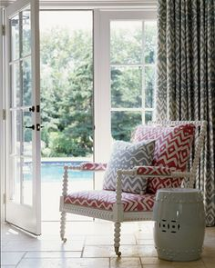 Love the pink chair with the gray pattern drapes