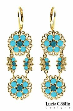 Lucia Costin Dangle Flower Earrings Made of 14K Yellow Gold over .925 Sterling Silver with Turquoise - Green Swarovski Crystals, 6 Petal Flowers, Filigree and Leaf Details; Handmade in USA Lucia Costin. $87.00. Embellished with blue - green and turquoise Swarovski crystals. Mesmerizing enough to wear on special occasions, but durable enough to be worn daily. Floral earrings amazingly designed by Lucia Costin. Unique jewelry handmade in USA. Splendid combination of dangle elements