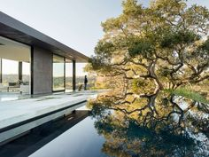 For instance, an infinity pool on the ground level rests just underneath a large oak. Perhaps not the perfect design for the pool filter, the aesthetics are truly amazing. A dip in this pool is a luxurious version of a backhills swimming hole, complete with modern concrete deck and stylish deck chairs.