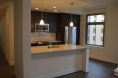 Hereu0027s An Apartment Kitchen With Dallas White Granite Countertops.  #Countertops #Granite