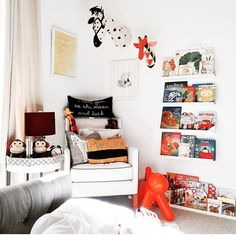 The shelves, the animal heads and the pillows! @leatherandrhymes #estella #kids #decor