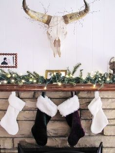 holiday mantel+christmas mantle+stockings on the fireplace+cow skull with holiday decor+light Minimal Christmas, Modern Christmas, All Things Christmas, Christmas Time, Christmas Ideas, Merry Christmas, Christmas Tables, Purple Christmas, Coastal Christmas