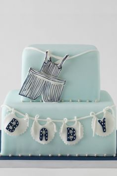 baby shower cake @Crystal Howell I was talking about (want NATE spelled out instead on the bottom layer. A Bowtie on the top layer instead of overalls) And I have Mustache ribbon for the bottom layer