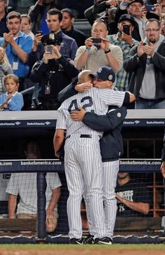 New York Yankees manager Joe Girardi hugs pitcher Mariano Rivera