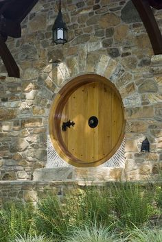 The signature round hobbit door, a detail taken straight out of Tolkien's text, is custom made of Spanish cedar.