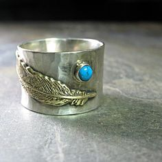 Wind Spirit - wide band feather ring in sterling silver and brass with choice of stone    ...from LavenderCottage on Etsy