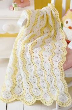 Learn to Crochet Mile-a-Minute BabyAfghans - When you need a quick gift for a shower, choose a mile-a-minute baby afghan! Mile-a-minute designs all have an easy, repetitive pattern that you can finish fast. The tutorial and sample project in this book explain how it works, and the six afghans show some of the many styles that are possible. What they all have in common is that they are crocheted in narrow panels, either in short rows or around a long beginning chain; then a border is added…