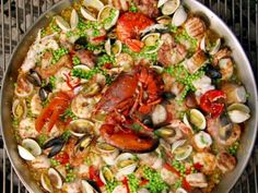 Paella on the Grill by Bobby Flay... for someday when I have a huge paella pan ...